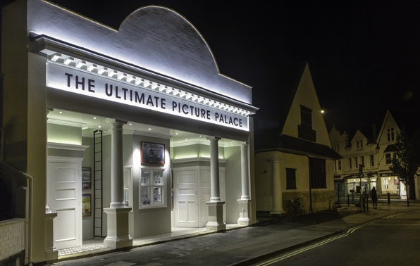 The front of The Ultimate Picture Palace at night