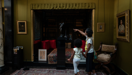 Families browsing Enchanting Stories Summer at Leighton House