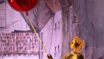 Image from production of The Red Balloon at Longfield Hall, featuring a puppet and a red balloon