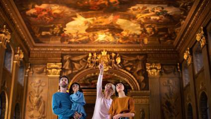 Family looking at the transformed Painted Hall at the Old Royal Naval College