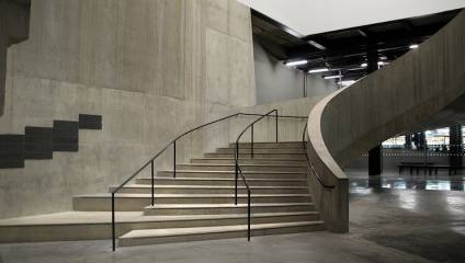 Interior shot of Tate Modern concrete stairs and brutalist architecture